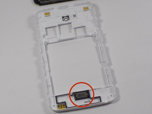 The speaker is located on the bottom of the back inner case. To remove it, use a pair of angled tweezers.