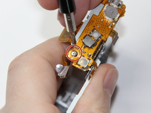 Image 1/1: The motherboard, Lens, and Flash assemblies do not need to be removed to access and remove the shutter button.