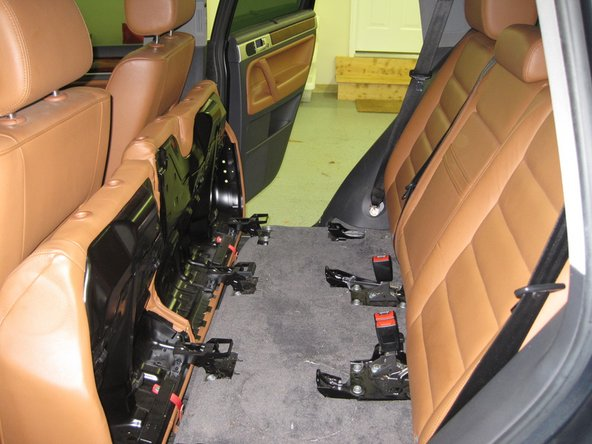 Image 2/3: Flip the bottom of the seats forward.  Remove the headrests, and lay the seat-backs down flat.