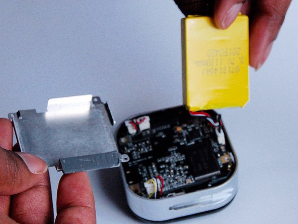 Next, take out the battery and the silver protector.
