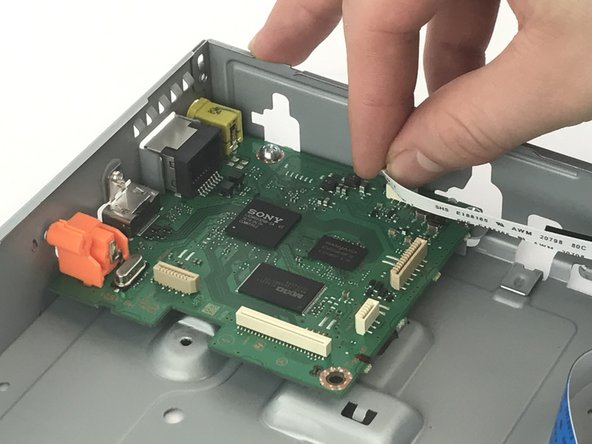 Remove the ribbon connecting the Wi-Fi module to the motherboard.