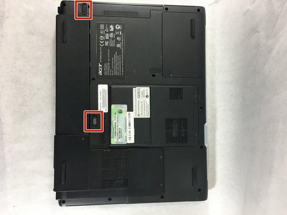There will be two switches on the back of the laptop: one at the top of the battery, and one at the bottom.