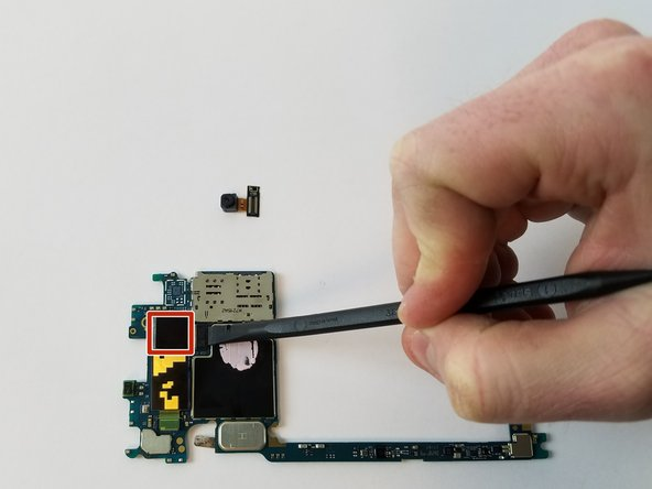 Remove the two rear-facing and front-facing cameras from the motherboard.