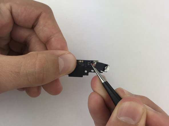 Pop up on the vibrator's connector to separate it from the charging port.