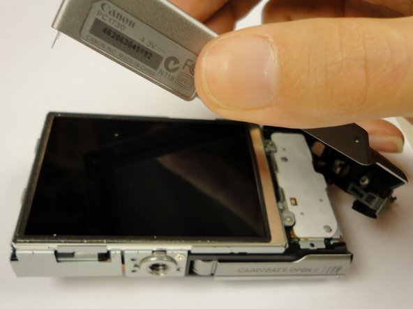 The back cover can be gently pried off after the screws are removed.