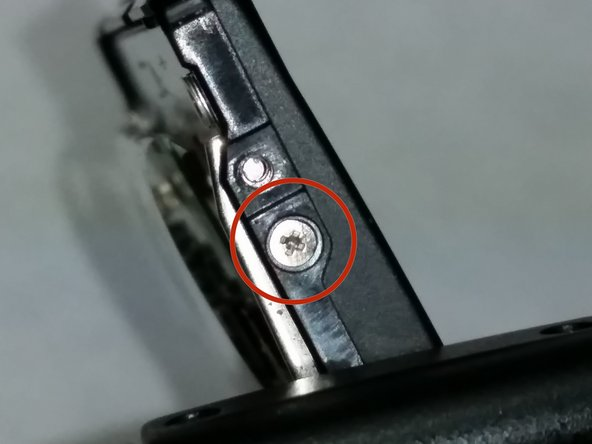 Image 1/2: Once this screw comes off the top case will come off and the LCD screen will be held by only the wires so handle it carefully so as not to damage the wires.