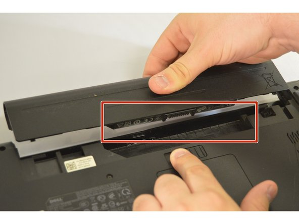 Push the new battery into the battery port until you hear a click