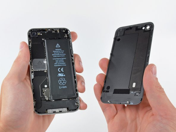 Image 1/3: Removing rear panel gives us a pretty good look at the iPhone 4's innards.