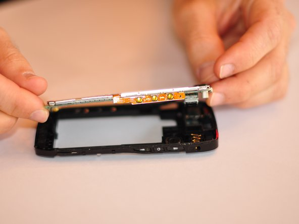 This will require some force and maneuvering. Be careful not to break phone back or motherboard.