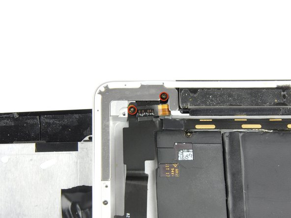Remove the two 2.9 mm Phillips screws securing the headphone jack to the rear panel.