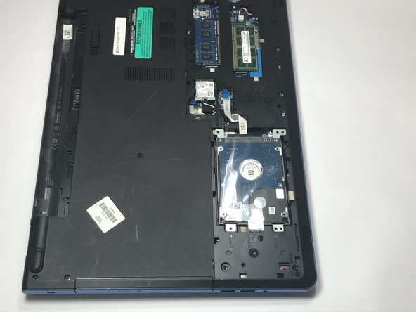 Carefully remove the hard drive and its assembly from the laptop.