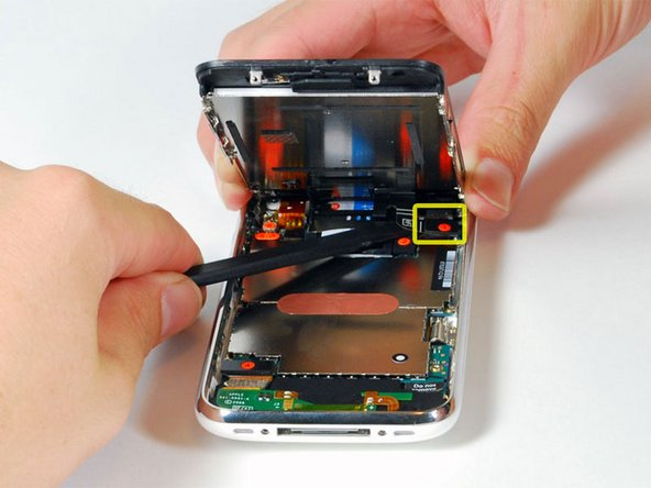 "Image 1/1: Continue to hold the display assembly with one hand, and use your other hand and a spudger to disconnect the black ribbon cable labeled ""1."""