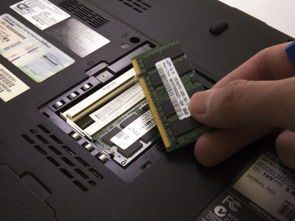 If using too much force, push aside the metal holdings that holds on to the RAM chip on both side then attempt lifting it up