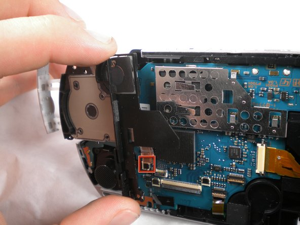 Remove the cable from the connector and remove the entire black piece from the PSP.