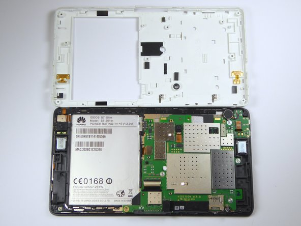 Using a plastic opening tool, pry off the back casing gently on each side of the tablet.