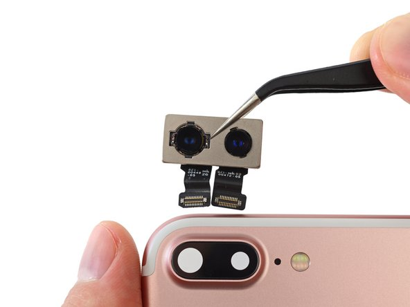 Apple's got us seeing double as we pull out the camera array with two separate sensors, two lenses, and two little connectors.