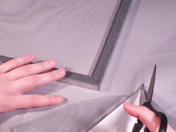 Use a pair of scissors or a utility knife to cut off from the roll of mesh, leaving around an extra inch outward from the frame.