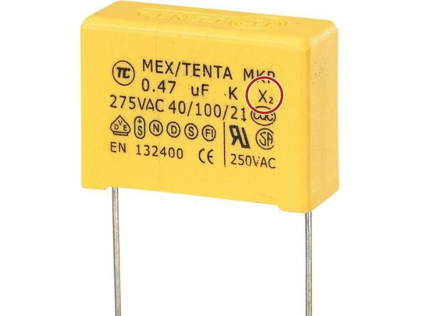 The capacitor specification should be: 470nF, min. 275 VAC, 22.5 mm pitch. Only use X2-Class qualification which can be distinguished on the part. Capacitors come in blue and yellow colors.