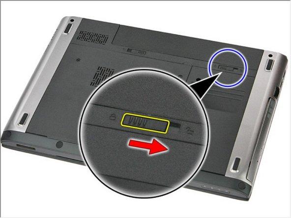 Deslice los pestillos de liberación para desbloquear la batería.