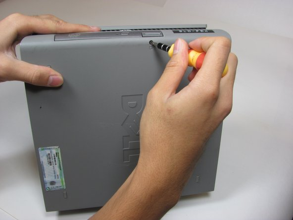 Remove the small black screw connecting the Optical Drive to the computer.