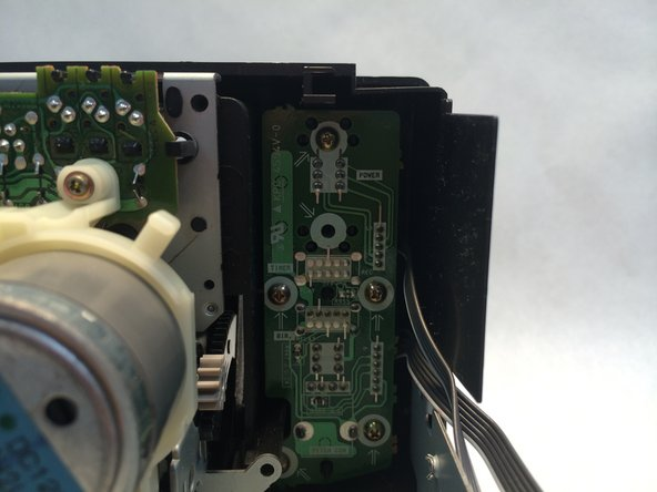 Unscrew all five 7.5mm Phillips head screws from the PCB (printed circuit board) behind the power switch.