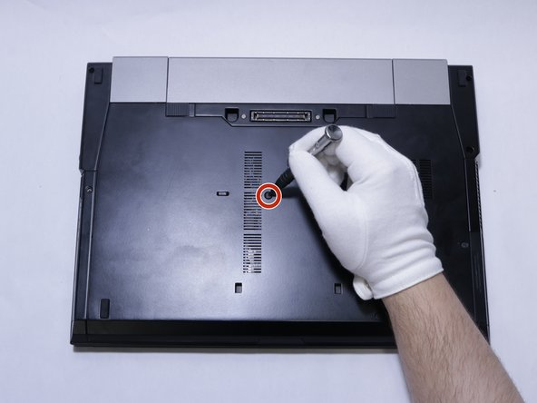 Use a J0 screwdriver to remove the single screw on the back of the device.
