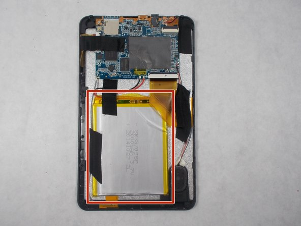 Image 1/1: Use the iFixit plastic pry tool in order to pry the battery up from the  metal plate it's stuck to.
