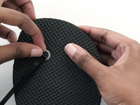 Push the head end into the hole of the flip-flop.
