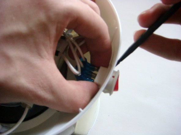 Gently squeeze the sides of the Power Switch, while using a Spudger to help pop out the Power Switch.