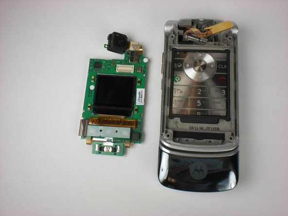 Gently remove the green logic board/LCD (Liquid Crystal Display) screen away from the phone.