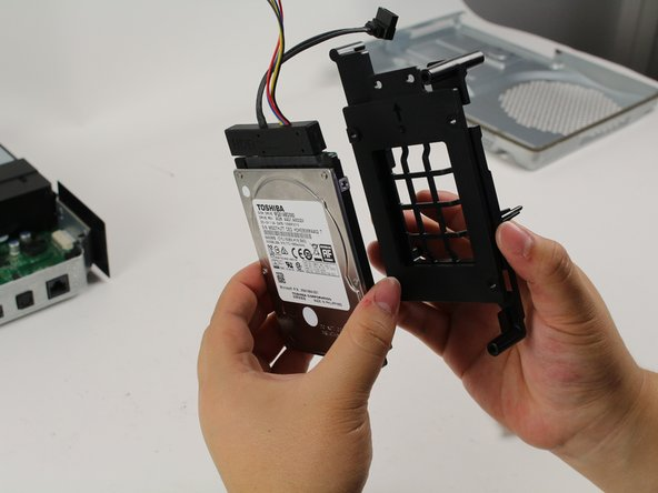 Detach the black plastic mount and the wires from the hard drive.