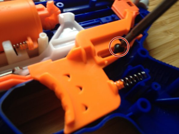 Remove the screw that holds the trigger in place.