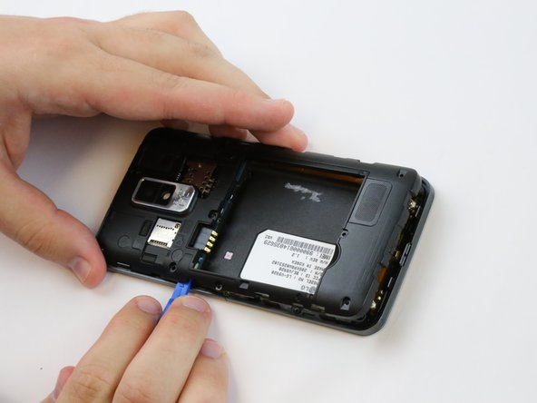 Use the plastic opening tool to firmly pry up the plastic backing around the perimeter of the phone.