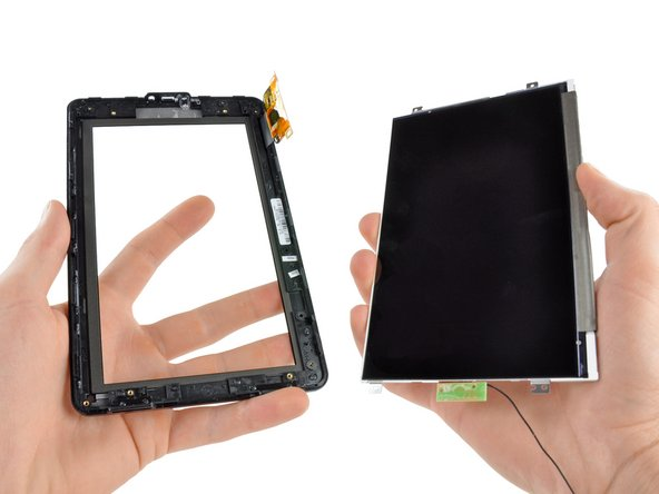 Rotate the LCD and front glass panel slowly so you don't damage the antenna on the bottom of the LCD.