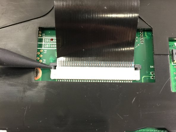 Once both retaining clips have been lifted up, the ribbon cable should release with a gentle pull.