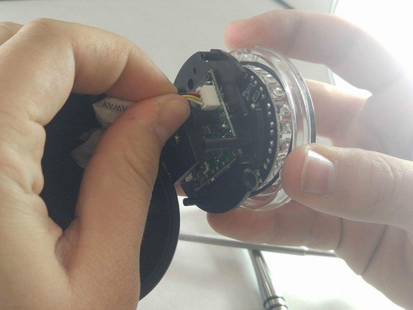 Once the camera is removed, remove the wires from the outer containment shell.