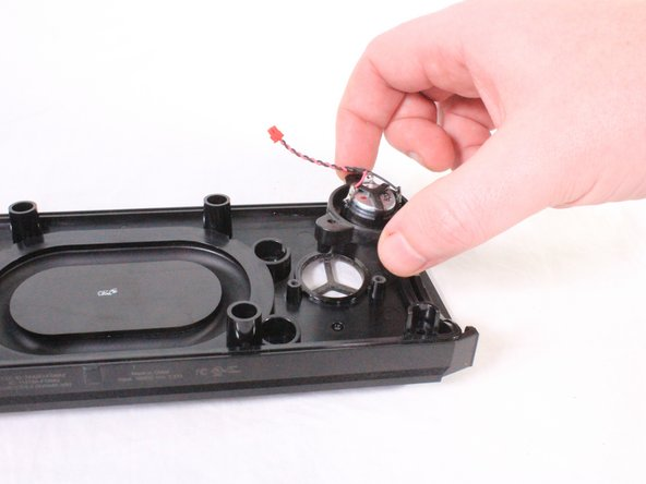 Once the screws are removed, carefully lift the speaker from the casing.