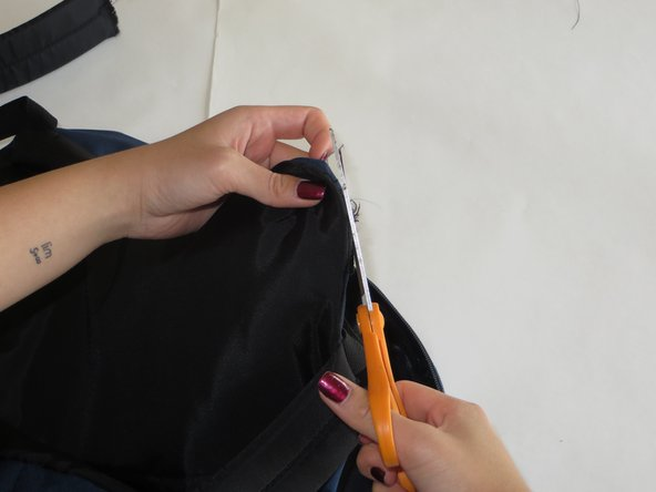 Trim the frayed edges and thread off of the backpack and shoulder strap.