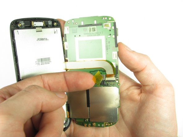 Split apart the motherboard and front panel. Remove the other yellow piece of tape off of the end of the ribbon cable.