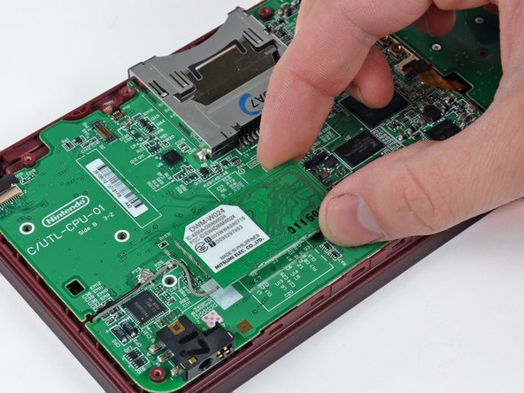 Lift the Wi-Fi board from its edge nearest the center of the DSi, and it comes right off the logic board.