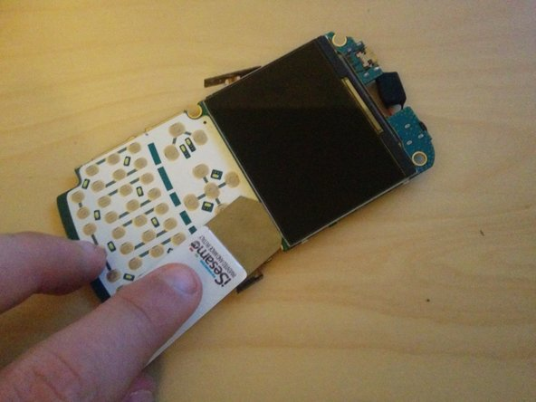 Use a thin opening tool to separate the LCD from the main board.