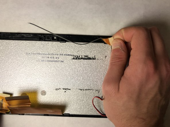 Remove the grey wire from the back of the screen display.