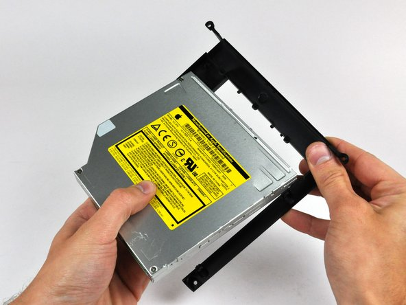 Pull the optical drive bracket away from the open end of the optical drive, minding any tabs that may get caught.