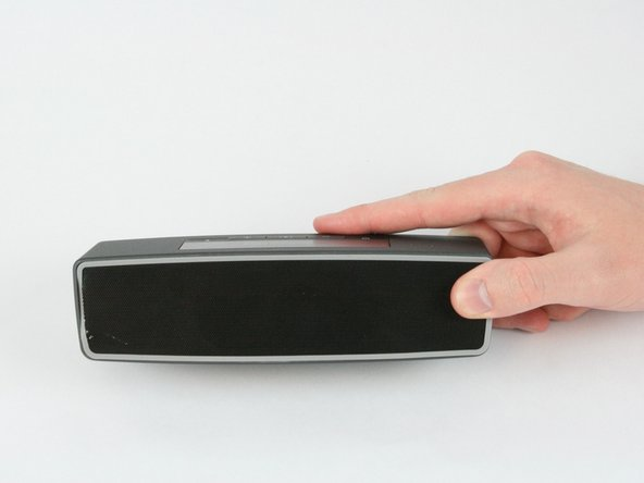 Flip the speaker over onto its back.