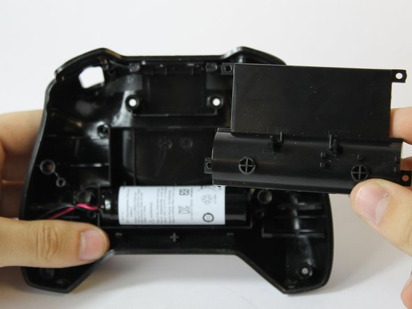 Remove the panel from the front case.
