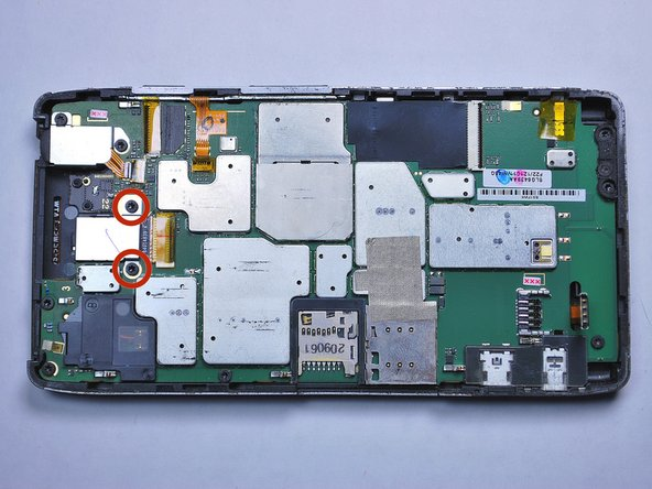 Using a T5 Torx screwdriver, unscrew the two 4.0mm screws on the rear-facing camera cover.