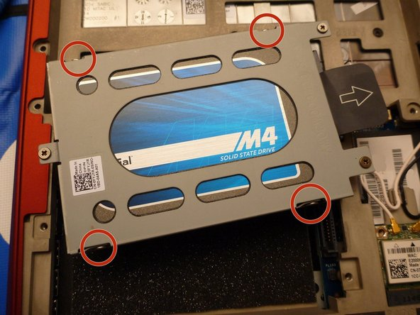 In order to remove the hard drive from the mounting bracket, remove the four screws at each corner with the Phillips #1 screwdriver, as shown.
