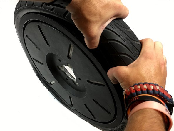 Use your hands to squish the tire all the way around the sides to make sure the tire is off the Segway rim completely.