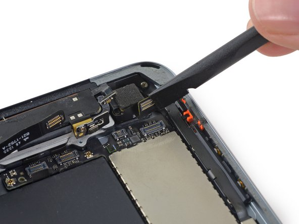 Fold the rear-facing camera cable out of the way of the logic board.