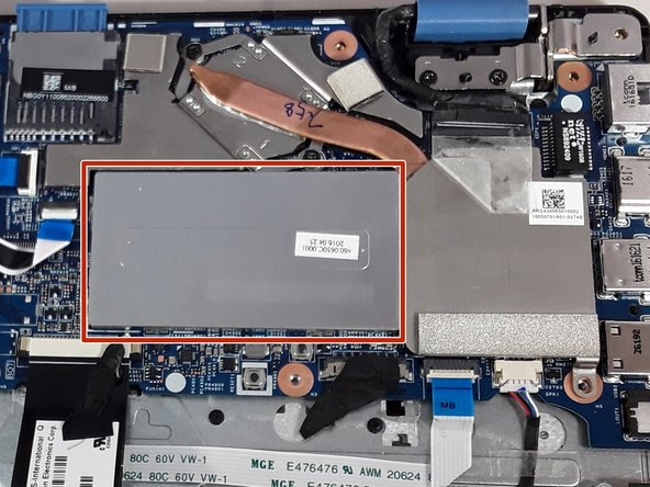 Locate the large silver rectangle to the right of the hard drive. This is where your ram is located.